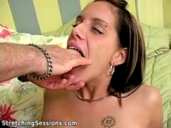 Toying her pussy.