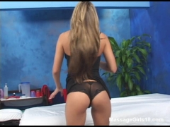 Hot latina gets ready to give a warm massage.