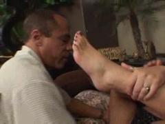 Girl licks cum off feet.