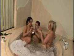 Blonde and brunette sharing a cock in the jaccuzi