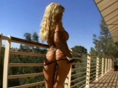 Hot blonde wearing fishnet fucks and sucks.
