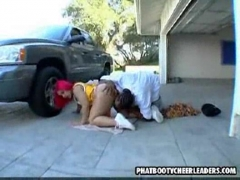 Fat booty cheerleader sucks in a garage.