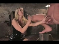 Male slave obeying his horny dominatrix.