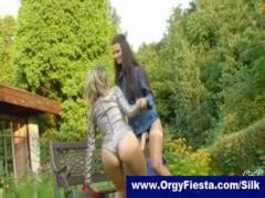Georgeous lesbians having strapon fun outdoors.