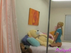 Sexy blonde student Love gets naughty on her bed.