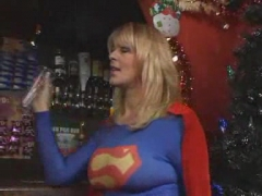 Guy eating mature superwoman's pussy in a bar.