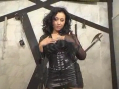 Latex MILF With Dildo In Dungeon.