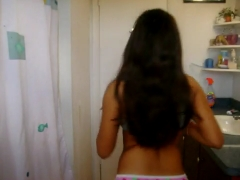 Latina teen showing off in the bathroom.