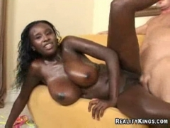 Busty black girl fucked on the couch.