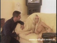 Sexy blonde  fucked by hot young stud.