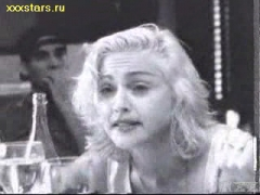Madonna sucks on a bottle.