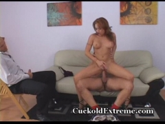 Sexy redhead enjoys hubby watching.