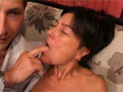 Hot MILF sucks and fucks on the couch.