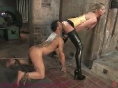 Latex clad dominatrix fucks up pain slut and makes him her little bitch.