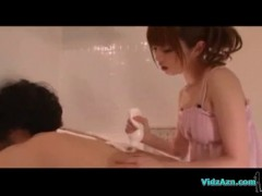 Asian girl massaging guy back with cream giving blowjob cum.