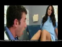 Busty brunette Kortney gives the podiatrist an intriguing foot job.