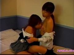 Schoolgirl licked fingered on the bed.