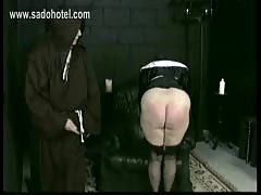 Horny nun slave is spanked on her big ass and hands by older.