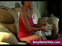 Fingering and pussy eating in home video.