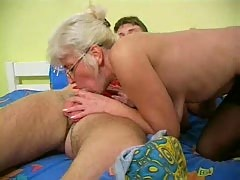 Mature with Silver Hair Glasses and Stockings Wakes the Boy.