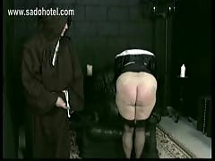 Horny nun slave is spanked on her well formed ass and hands.