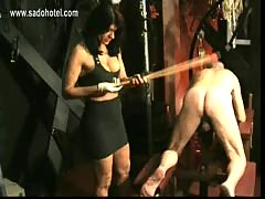 Masked slave got spanked on his ass by horny mistress with b.