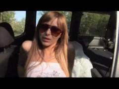 Brunette fucking in car - public