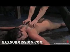 Bound to wooden floor brunette gets whipped