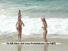 Two beautiful sexy blondes playing on the beach