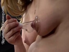 She's milking her puffy tits